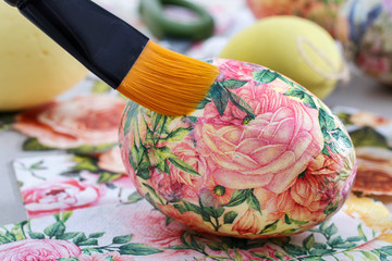 Decorating Easter eggs with decoupage technique.