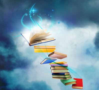 Flying books with fairytales and magic lights on blue background. Creative design