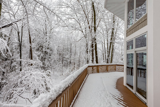Deck on Home in Snowy Woods in Winter
