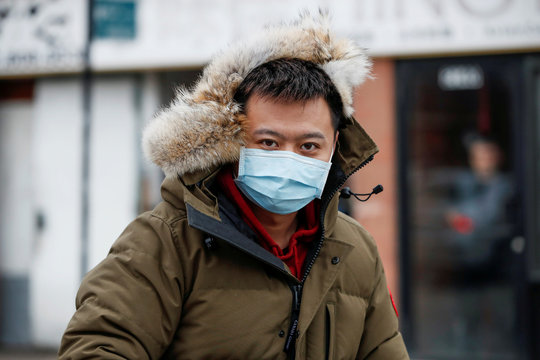 A man wears a masks in Chinatown following the outbreak of a new coronavirus, in Chicago