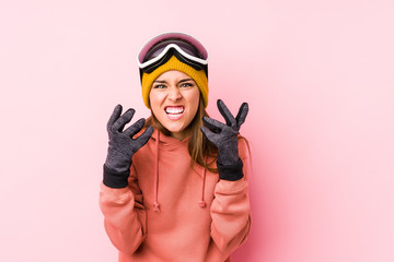 Young caucasian woman wearing a ski clothes isolated upset screaming with tense hands.