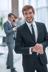 smiling business men standing in the office