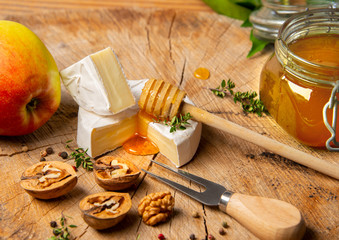 Wall Mural - cheese and honey on old wooden table