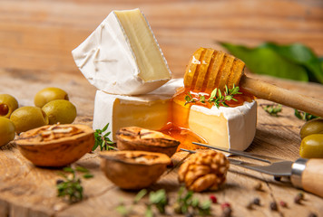 cheese and honey on old wooden table