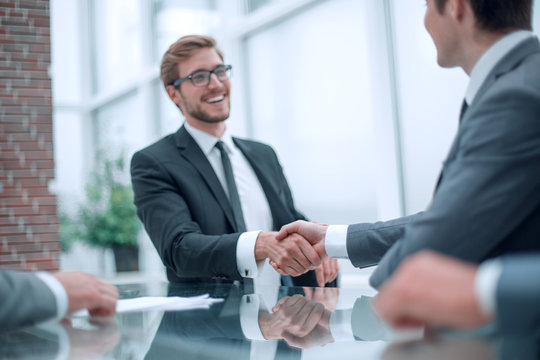 business partners greet each other at a business meeting.