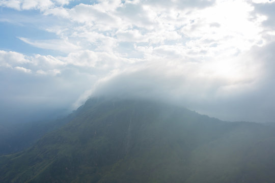 Mountain landscape, green slopes. Beauty of mountains. Little Adam peak, mountain in the fog view from the jungle