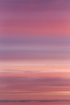 Dramatic soft sunrise, sunset pink violet sky with clouds background texture