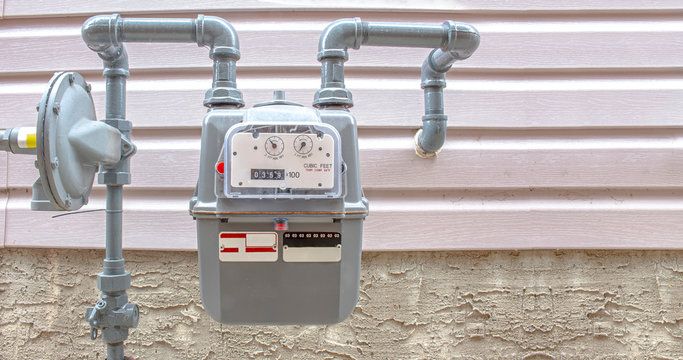 Residential urban natural gas meter measuring gas consumption, outside house gas meter