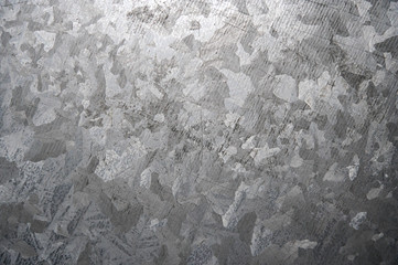 High resolution photograph of a weathered galvanized steel surface.