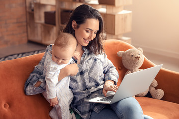 Working mother with her baby at home