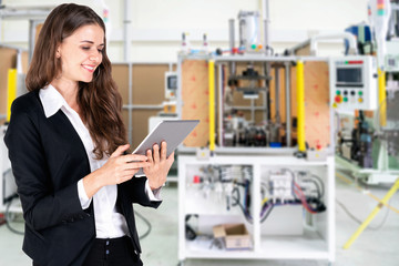 The business woman check list and quality of product before send to the customer.