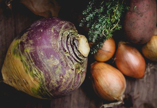 Rutabaga And Onions On Table