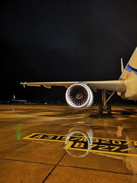 Airplane On Wet Runway At Night