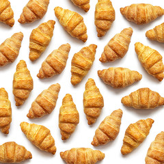 French croissants made of puff pastry on a white background