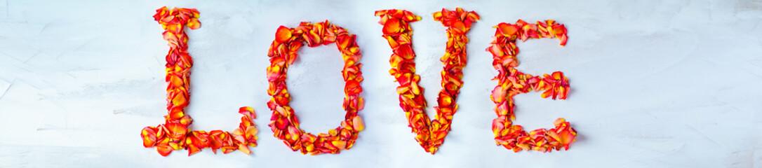 The inscription LOVE of rose petals