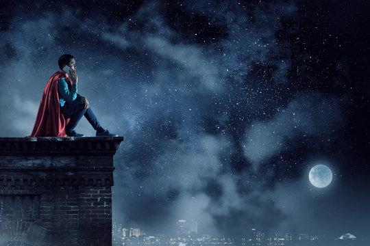 Super hero on roof. Mixed media