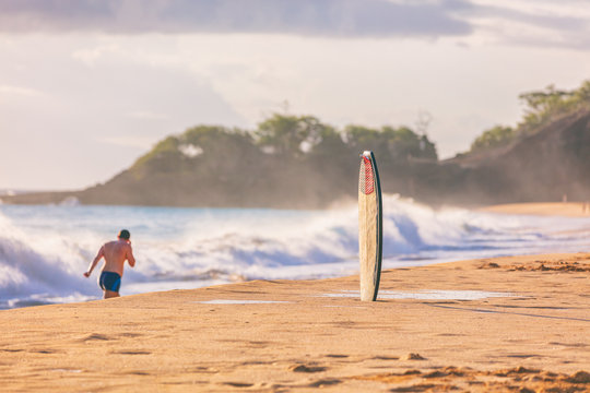 Hawaii beach background summer lifestyle surfers with surfboard on sand ready to surf at sunset.