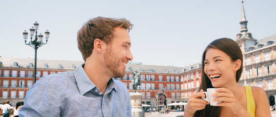 Aufkleber - Couple drinking coffee at Madrid cafe dating laughing panoramic banner. Two tourists peaple having fun conversation talking on outdoor Plaza Mayor terrace summer travel vacation. Young woman and man.