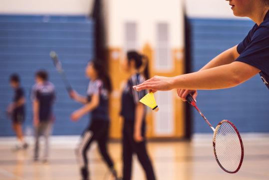 girl serving in badminton