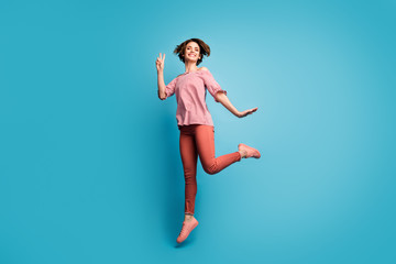 Full body profile photo of beautiful pretty lady jumping high good mood showing v-sign symbol wear...