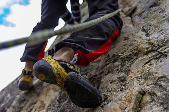 Low Section Of Man Climbing Rock