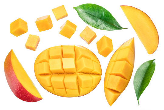Set of mango cubes and mango slices isolated on a white background.