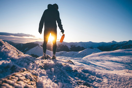 Man hiking in the mountains in winter