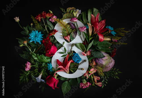 Colorful 8 March. Floral Greeting card. Happy Women's Day. Flower and leaves flat lay spring holiday background with number 8, space for text. Nature Trendy Design. Happy Mother's Day.