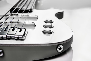 White bass guitar details on a white background with copy space