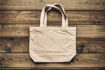 Zero waste, Recycling, Sustainable lifestyle concept. Eco-friendly cotton bag on wooden background