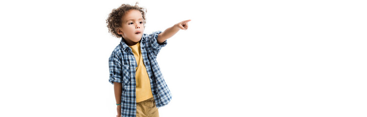 panoramic shot of little african american boy pointing isolated on white