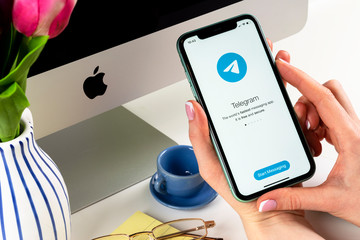 Helsinki, Finland, January 30, 2020: Telegram application icon on Apple iPhone 11 screen close-up in woman hands. Telegram app icon. Telegram is an online social media network. Social media app