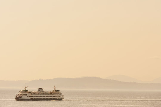 Ferry boat carrying passengers and cars across Puget Sound from Seattle towards Olympic peninsula, Washington, USA