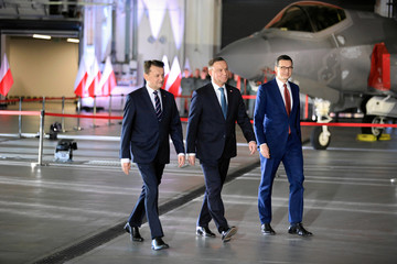 Poland's Prime Minister Morawiecki, President Duda and Defence Minister Blaszczak attend a ceremony to sign a contract for the purchase of Lockheed Martin F-35 fighter jets in Deblin