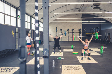 group of people training gym crossfit power lifting