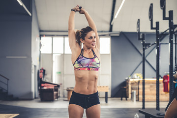young woman training gym crossfit