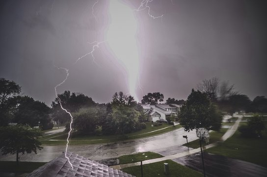 Lightning Strikes Over House At Mundelein