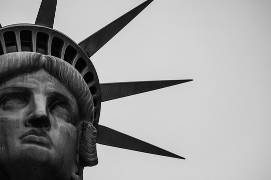 Cropped Image Of Statue Of Liberty Against Clear Sky