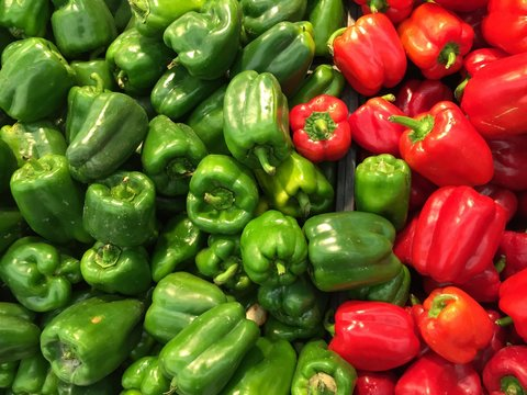 High Angle View Of Multi Colored Bell Peppers For Sale In Supermarket