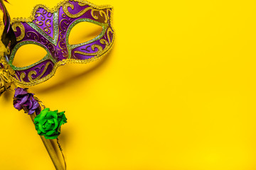 Wall Mural - Mardi Gras mask on a bright yellow background