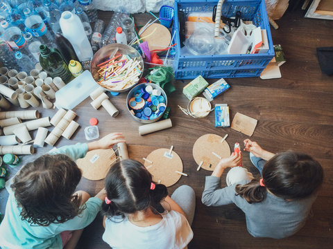 High Angle View Of Girls Making Art Indoors