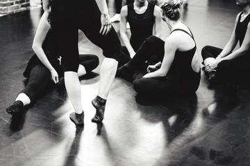 Ballet Dancers Relaxing At Dance Studio