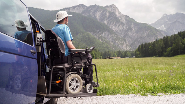 Disabled Man on Wheelchair using Accessible Vehicle with Lift or Ramp in Nature
