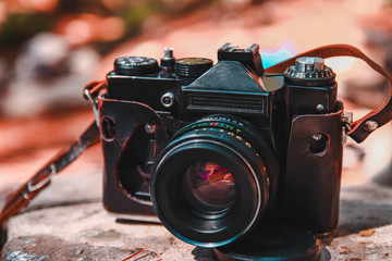 film camera on a stone in a leather case with a large depth of field Wall mural