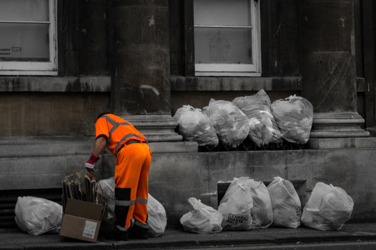 Full Length Of Man Of Collecting Garbage From Street