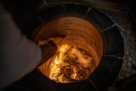 Bread in the Traditional Tandouri Oven. fresh and scorching tandir in a traditional oven.