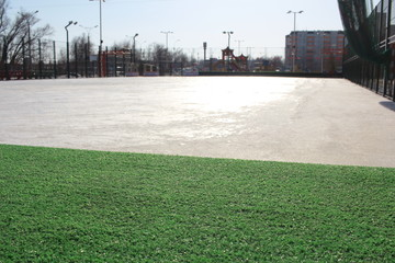 empty stadium with sports surface artificial grass for training