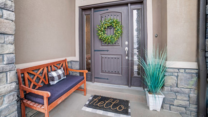 Panorama frame Beautiful home entrance with gray door sidelights and huge transom window