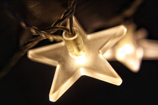 Close-Up Of Star Shape Christmas Lights At Night