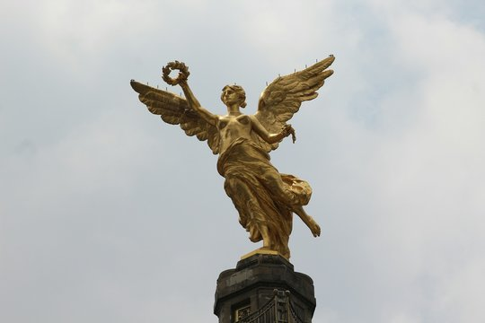 Low Angle View Of Angel Of Independence Against Sky